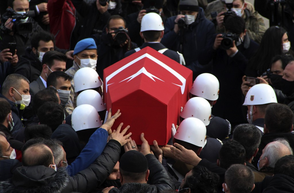 Turkish soldiers carry the national flag-draped coffin of Turkish soldier Er Sedat Sorgun, one of thirteen soldiers, police and civilians who had been...