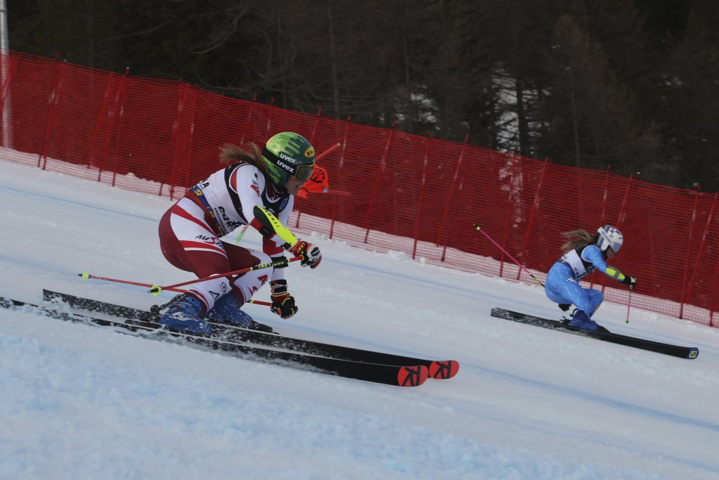Austria's Katharina Liensberger and Italy's Marta Bassino speed down the course on their way to win a gold medal during a parallel slalom, at the alpi...