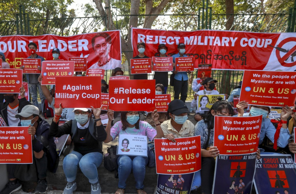 Demonstrators display placards supporting UN and U.S. actions against Myanmar military during a protest against the military coup in Yangon, Myanmar T...