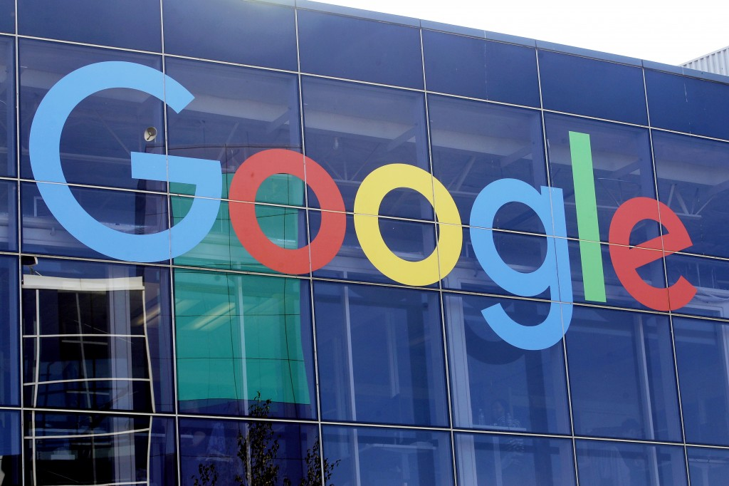 FILE - This Sept. 24, 2019, file photo shows a sign on a Google building at their campus in Mountain View, Calif.