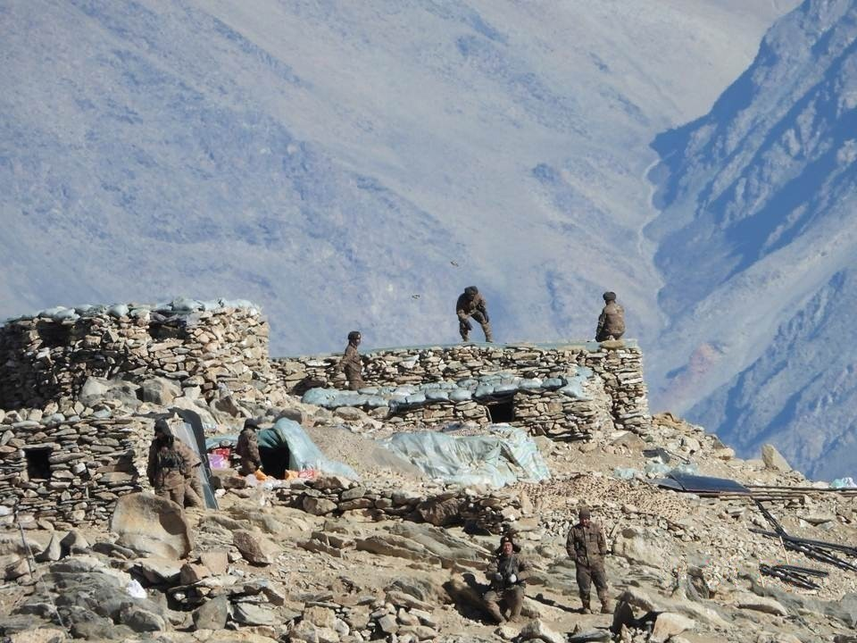 This photograph provided by the Indian Army, according to them shows Chinese troops dismantling their bunkers at Pangong Tso region, in Ladakh along t...
