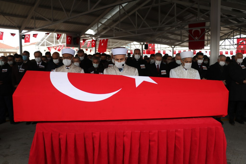 Imams hold prayers in front of the national flag-draped coffin of Turkish soldier Adil Kabakli, one of thirteen Turkish soldiers, police and civilians...