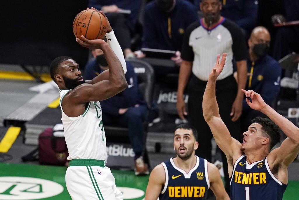 Boston Celtics guard Jaylen Brown, left, shoots over Denver Nuggets forward Michael Porter Jr. (1) and guard Facundo Campazzo, center, during the seco...
