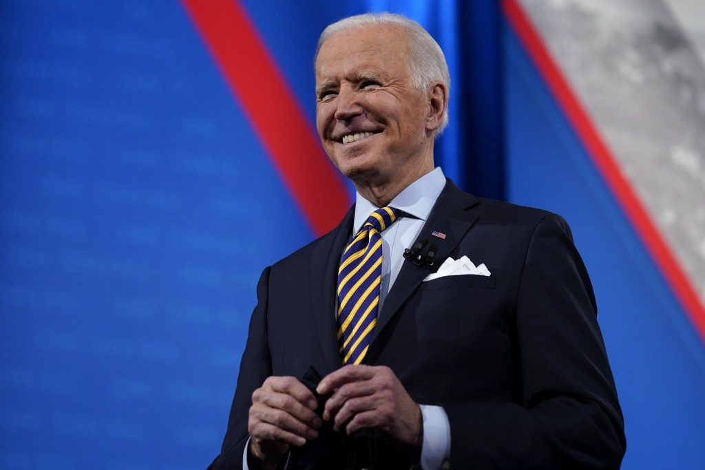 President Joe Biden stands on stage during a break in a televised town hall event at Pabst Theater, Tuesday, Feb. 16, 2021, in Milwaukee. (AP Photo/Ev...
