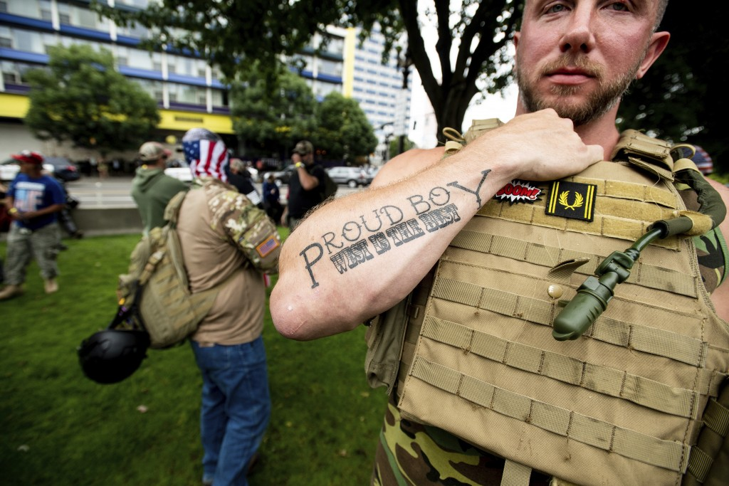 """FILE - In this Saturday, Aug. 17, 2019, file photo, Joseph Oakman, a member of the Proud Boys, wears body armor during an """"End Domestic Terrorism"""" ral..."""