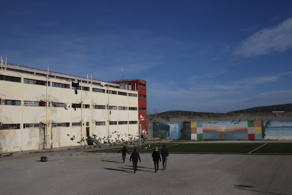 Inmates walk in the yard of Avlona prison, north of Athens, Wednesday, Feb. 10, 2021. With Greece's schools shut due to the pandemic, all lessons have...