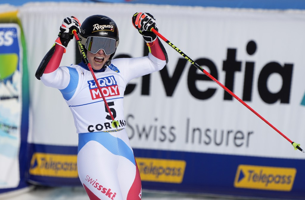 Switzerland's Lara Gut-Behrami celebrates in the the finish area after winning a women's giant slalom, at the alpine ski World Championships in Cortin...