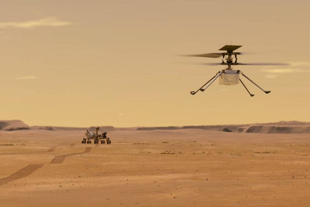 This illustration made available by NASA depicts the Ingenuity helicopter on Mars after launching from the Perseverance rover, background left. It wil...