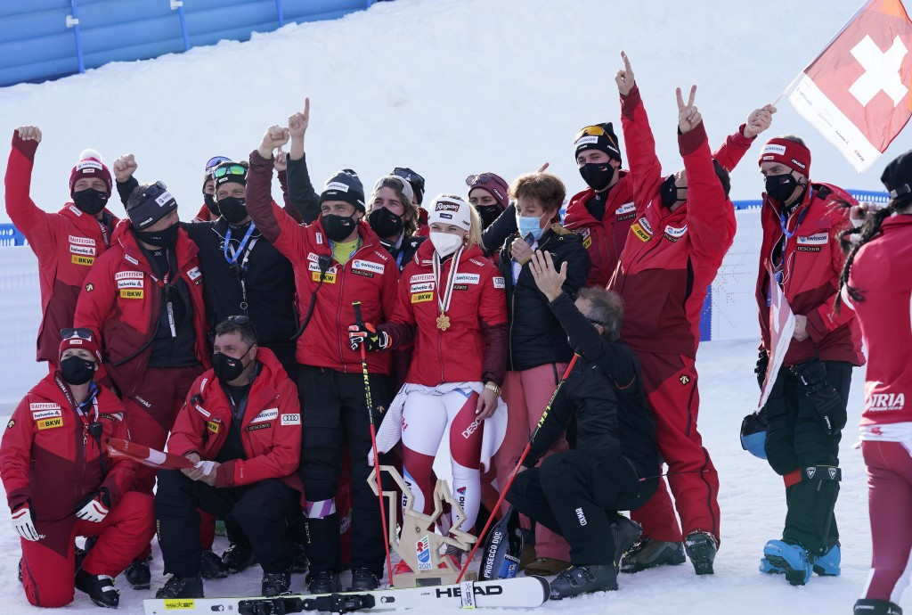 Switzerland's Lara Gut-Behrami celebrates with her team after winning a women's giant slalom, at the alpine ski World Championships in Cortina d'Ampez...