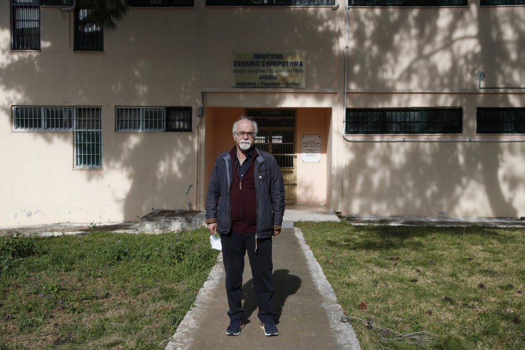 Prison school director Petros Damianos poses outside the building of Avlona's prison school, north of Athens, Wednesday, Feb. 10, 2021. With Greece's ...