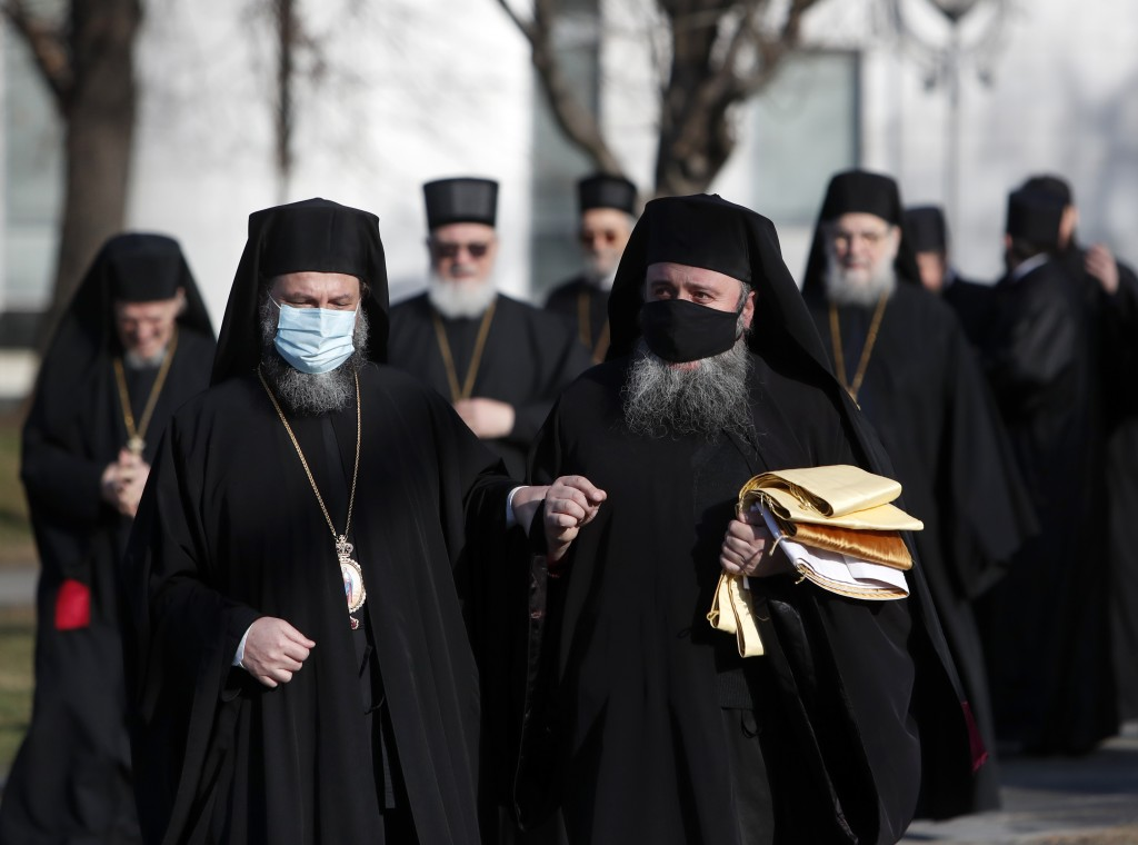 Serbian Orthodox Church bishops arrive in the St. Sava temple before church closed session in Belgrade, Serbia, Thursday, Feb. 18, 2021. The Serbian O...