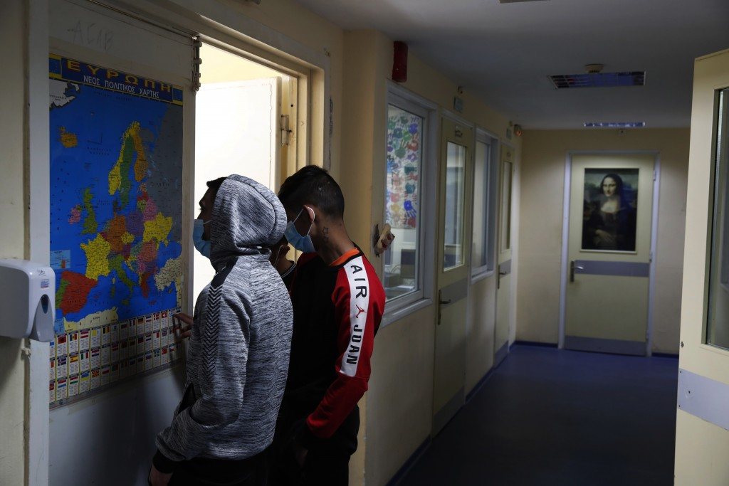Inmates look a map of Europe at Avlona's prison school, north of Athens, Wednesday, Feb. 10, 2021. With Greece's schools shut due to the pandemic, all...