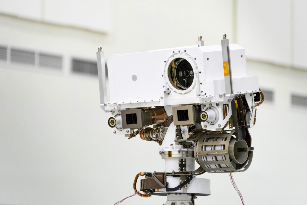 FILE - This July 23, 2019 photo made available by NASA shows the head of the Mars rover Perseverance's remote sensing mast which contains the SuperCam...