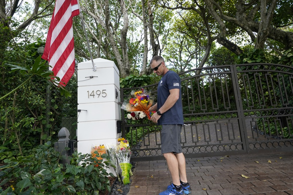 Logan Nichols vacationing from California drops off a bouquet of flowers at the home of talk radio host Rush Limbaugh, Wednesday, Feb. 17, 20121 in Pa...