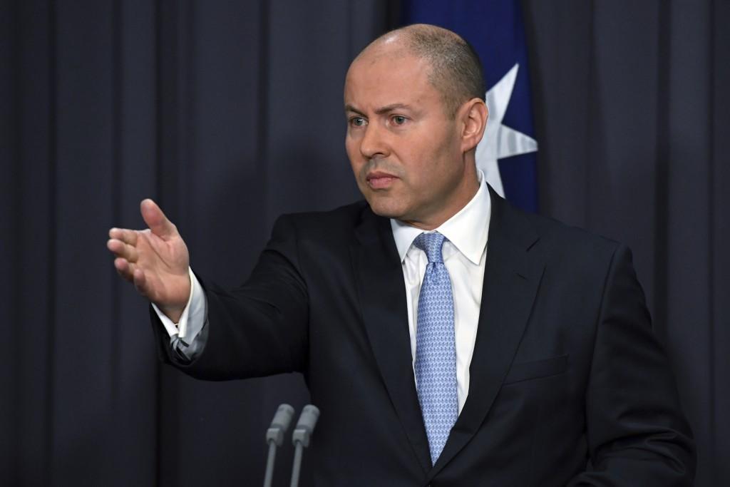 Australia's Treasurer Josh Frydenberg speaks at a press conference at Parliament House in Canberra, Thursday, Feb. 18, 2021. Frydenberg amended draft ...