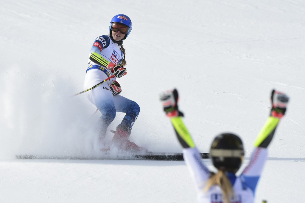 Switzerland's Lara Gut-Behrami celebrates winning the gold medal as United States' Mikaela Shiffrin comes in second in a women's giant slalom, at the ...
