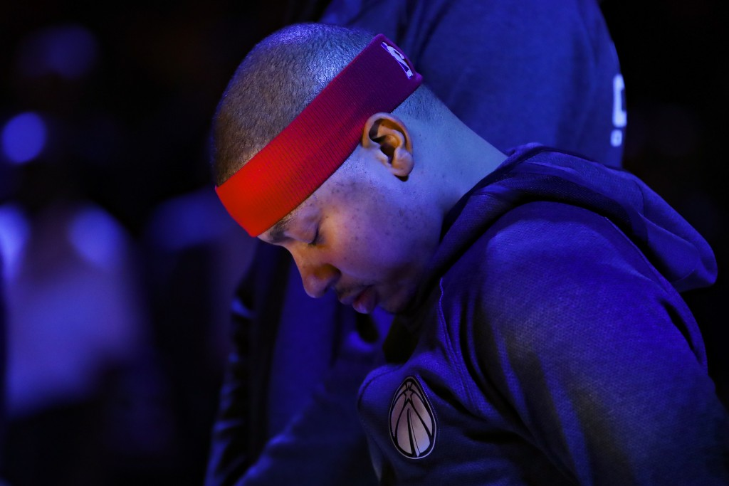 FILE - Washington Wizards guard Isaiah Thomas (4) stands during the National Anthem prior to an NBA basketball game against the Atlanta Hawks in Atlan...