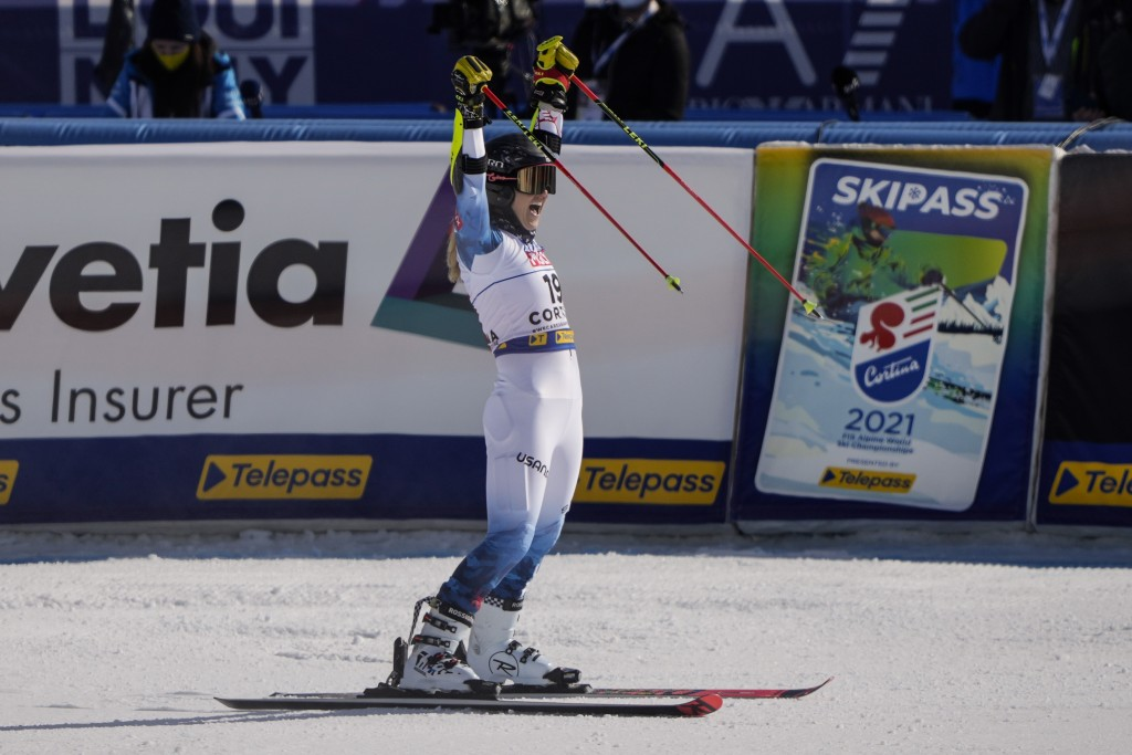 United States' Nina O Brien celebrates after competing in the first run of a women's giant slalom, at the alpine ski World Championships, in Cortina d...