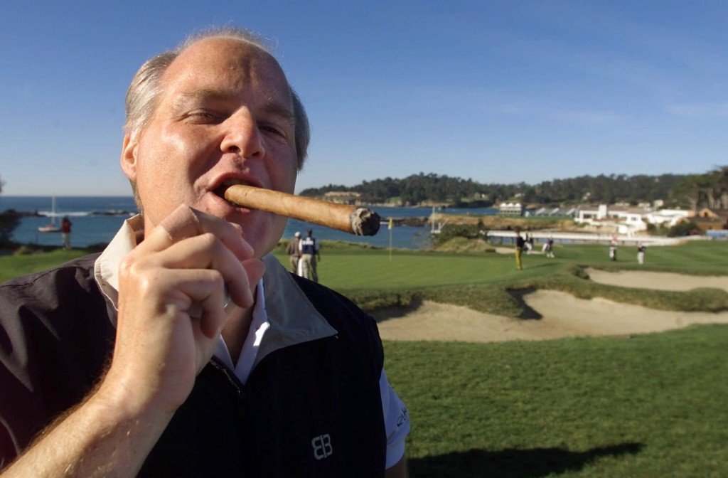 FILE - In this Feb. 3, 2001, file photo, Rush Limbaugh puffs on his Ashton VSG cigar while waiting to tee off from the fifth tee of the Pebble Beach G...