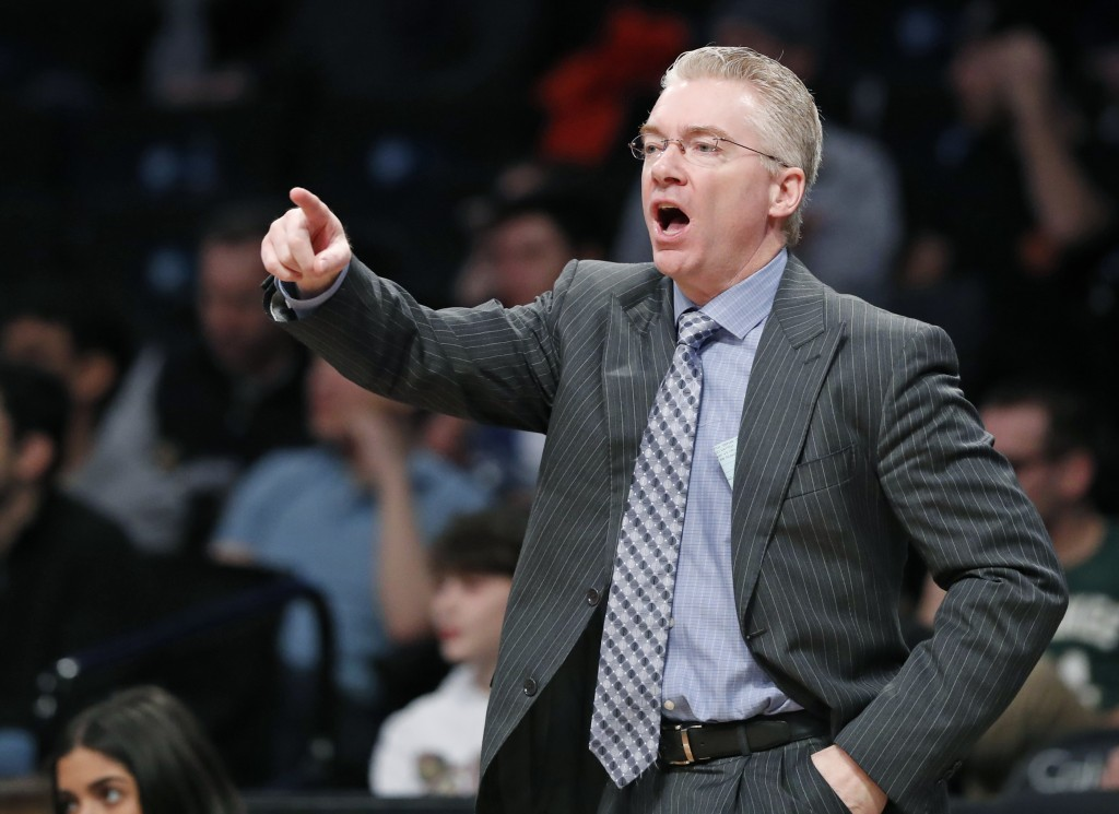 FILE - In this Sunday Feb. 4, 2018 file photo, Milwaukee Bucks interim head coach Joe Prunty yells at his players during the second half of an NBA bas...