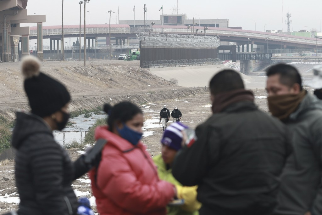 A Cuban migrant family is detained by National Guard soldiers along the Rio Grande in Ciudad Juarez, Mexico, Tuesday, Feb. 16, 2021. The number of peo...