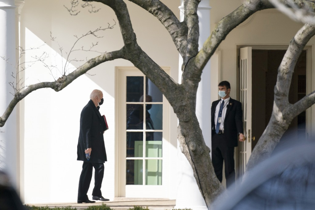 President Joe Biden walks to the Oval Office after traveling to Georgetown University to receive ashes for Ash Wednesday, Wednesday, Feb. 17, 2021, in...