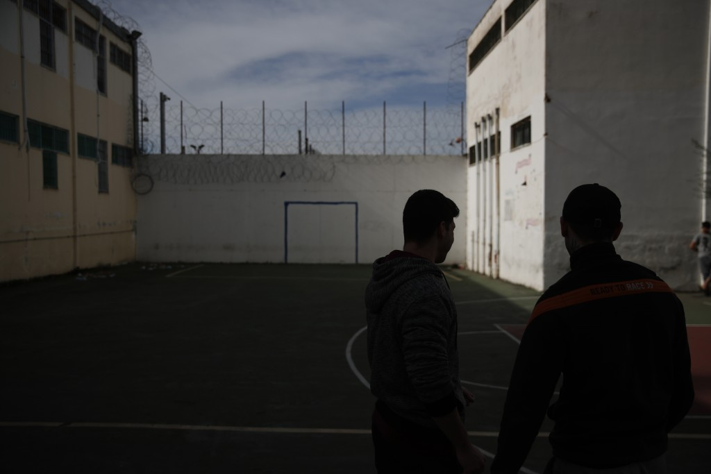 Inmates stand at the yard of their school in Avlona prison, north of Athens, Wednesday, Feb. 10, 2021. With Greece's schools shut due to the pandemic,...