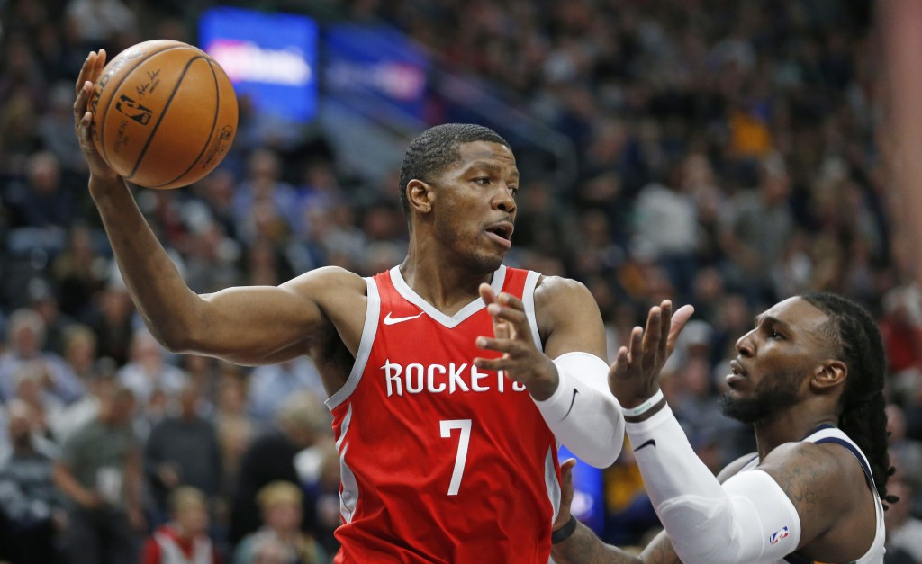 FILE - In this Monday, Feb. 26, 2018 file photo, Houston Rockets guard Joe Johnson (7) passes the ball after pulling down a rebound in front Utah Jazz...