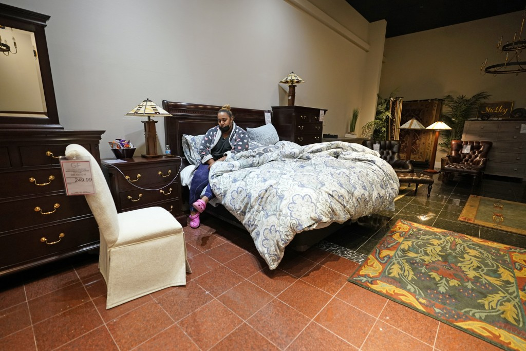 Taylor Brown wakes up after spending the night inside a Gallery Furniture store which opened as a shelter for those in need of food, water and heat We...