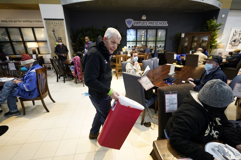 Owner Jim McIngvale collects trash inside his Gallery Furniture store which opened as a shelter Wednesday, Feb. 17, 2021, in Houston. Millions in Texa...