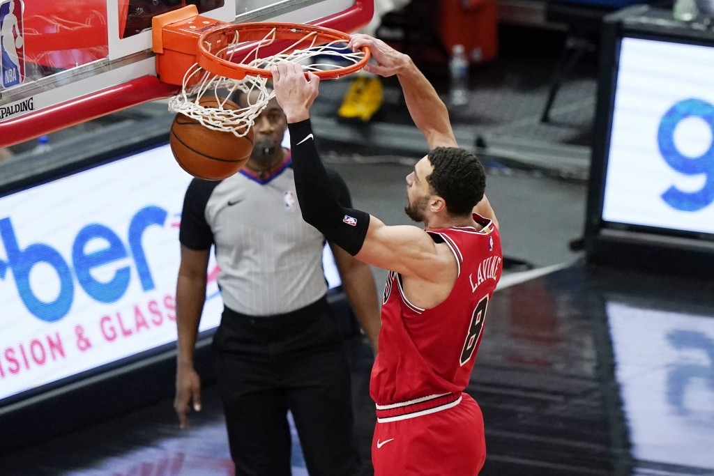 Chicago Bulls guard Zach LaVine dunks against the Detroit Pistons during the second half of an NBA basketball game in Chicago, Wednesday, Feb. 17, 202...