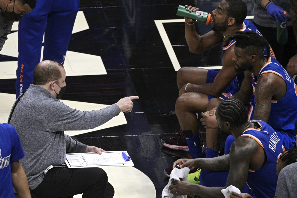 New York Knicks coach Tom Thibodeau, left, gives instructions during a timeout in the second half of the team's NBA basketball game against the Orland...
