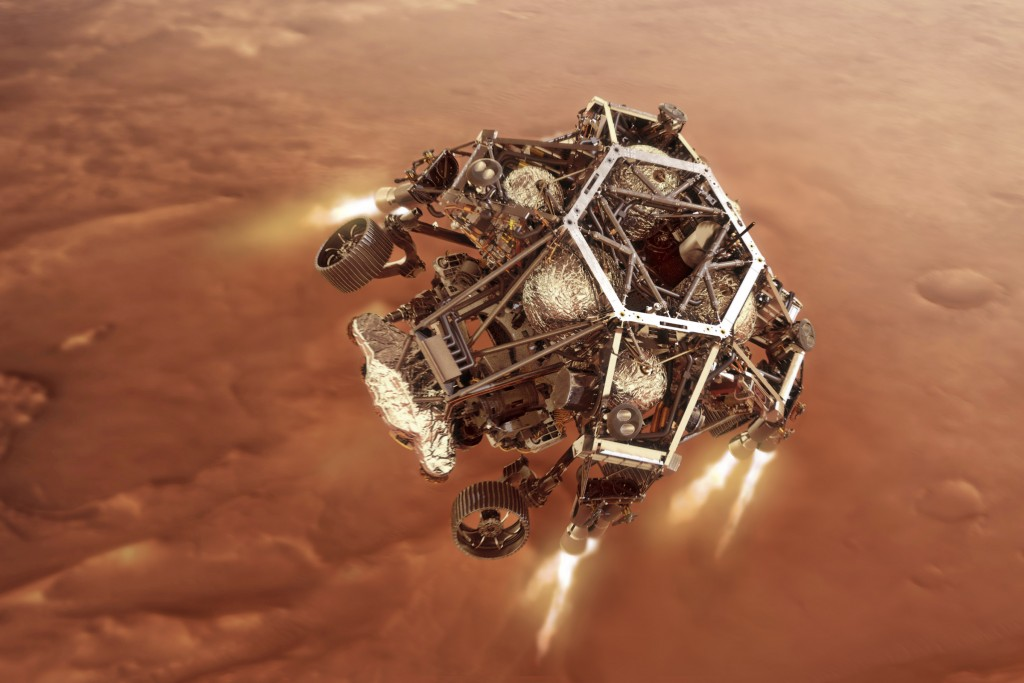 In this illustration provided by NASA, the Perseverance rover fires up its descent stage engines as it nears the Martian surface.. This phase of its e...
