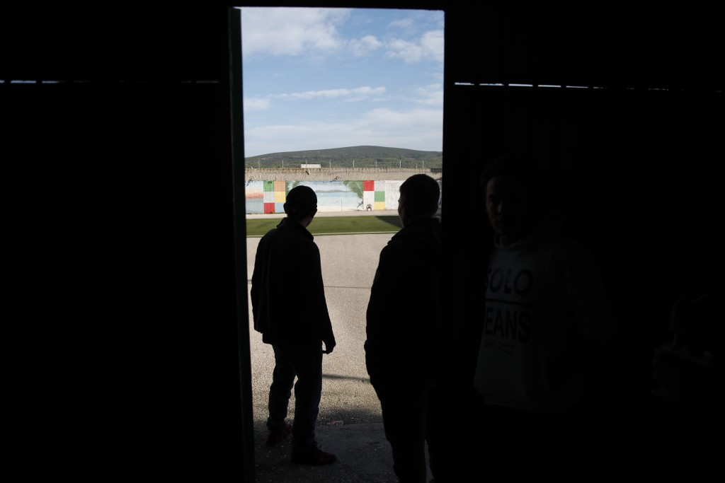 Inmates go to the yard of Avlona prison, north of Athens, Wednesday, Feb. 10, 2021. With Greece's schools shut due to the pandemic, all lessons have g...