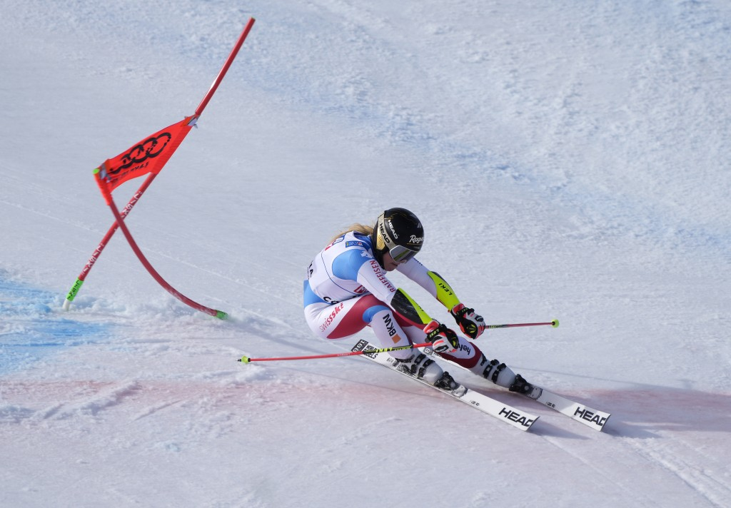 Switzerland's Lara Gut-Behrami powers pasta gate on her way to win a women's giant slalom, at the alpine ski World Championships in Cortina d'Ampezzo,...