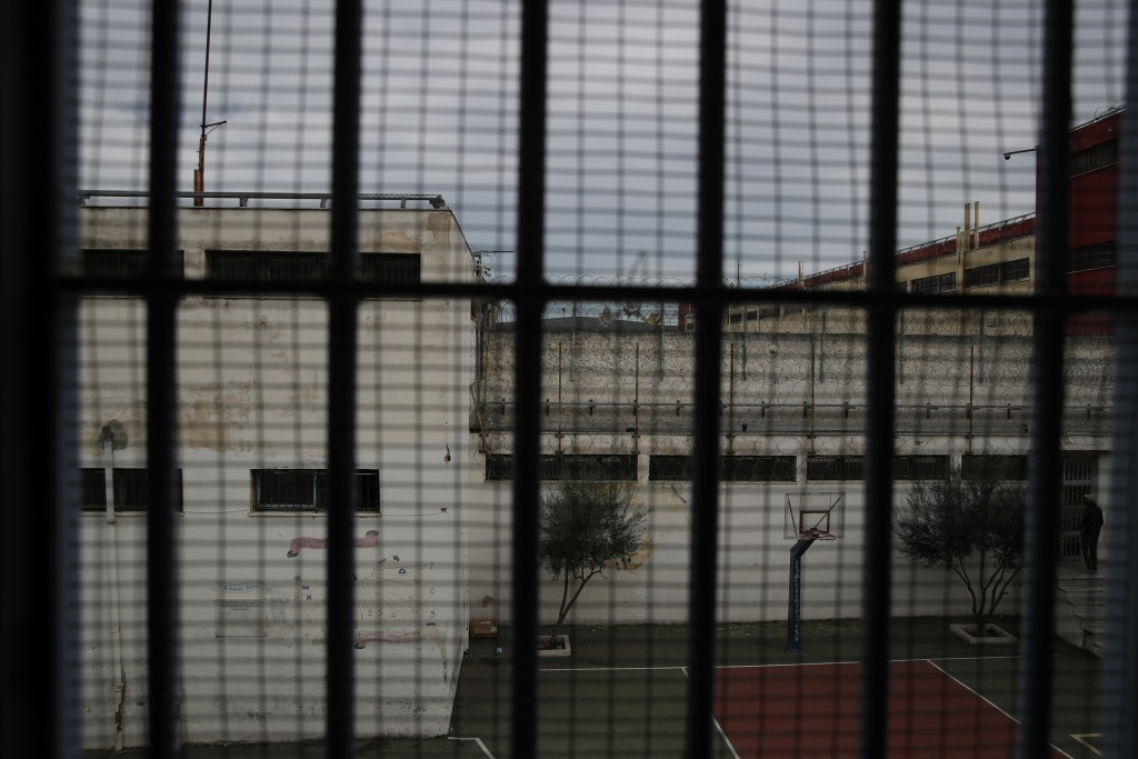 An inmate stands at the yard of his school in Avlona prison, north of Athens, Wednesday, Feb. 10, 2021. With Greece's schools shut due to the pandemic...