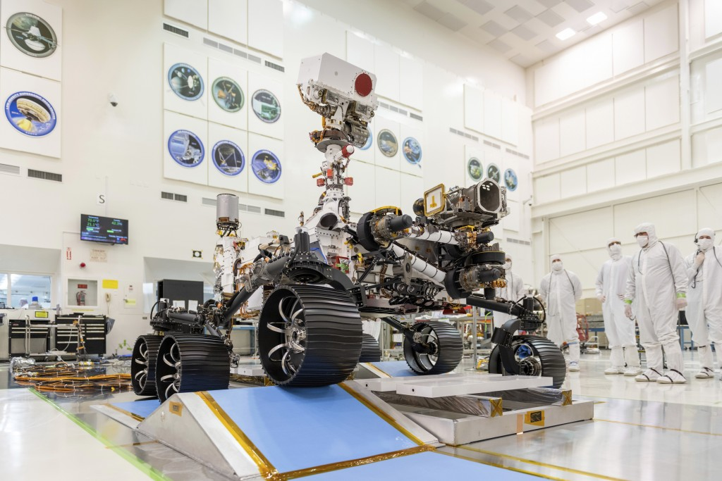 """FILE - In this Dec. 17, 2019 photo made available by NASA, engineers watch the first driving test for the Mars 2020 rover, later named """"Perseverance,""""..."""