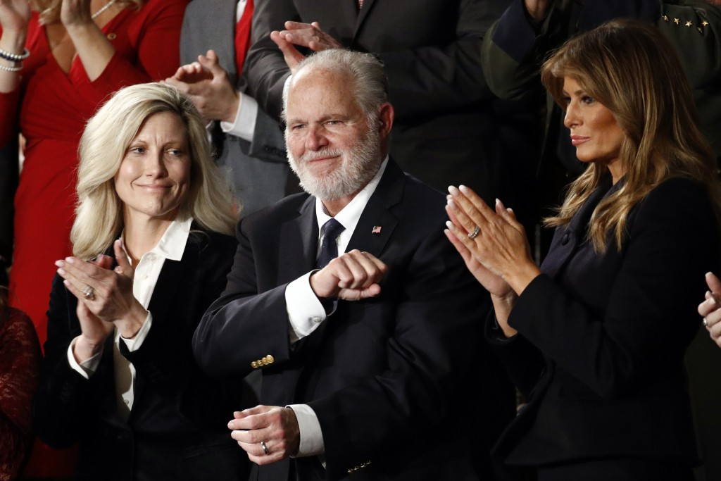 FILE - In this Feb. 4, 2020 file photo, Rush Limbaugh reacts as first Lady Melania Trump, and his wife Kathryn, applaud, as President Donald Trump del...