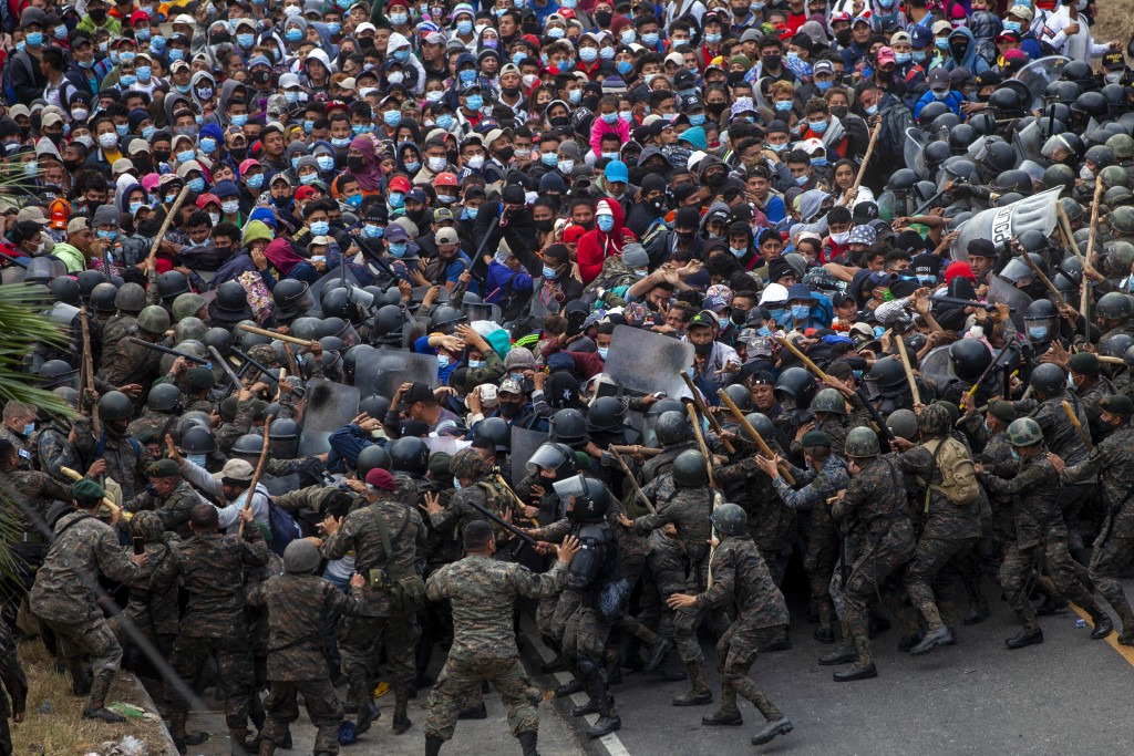 Honduran migrants clash with Guatemalan soldiers in Vado Hondo, Guatemala, Sunday, Jan. 17, 2021. Guatemalan authorities estimated that as many as 9,0...