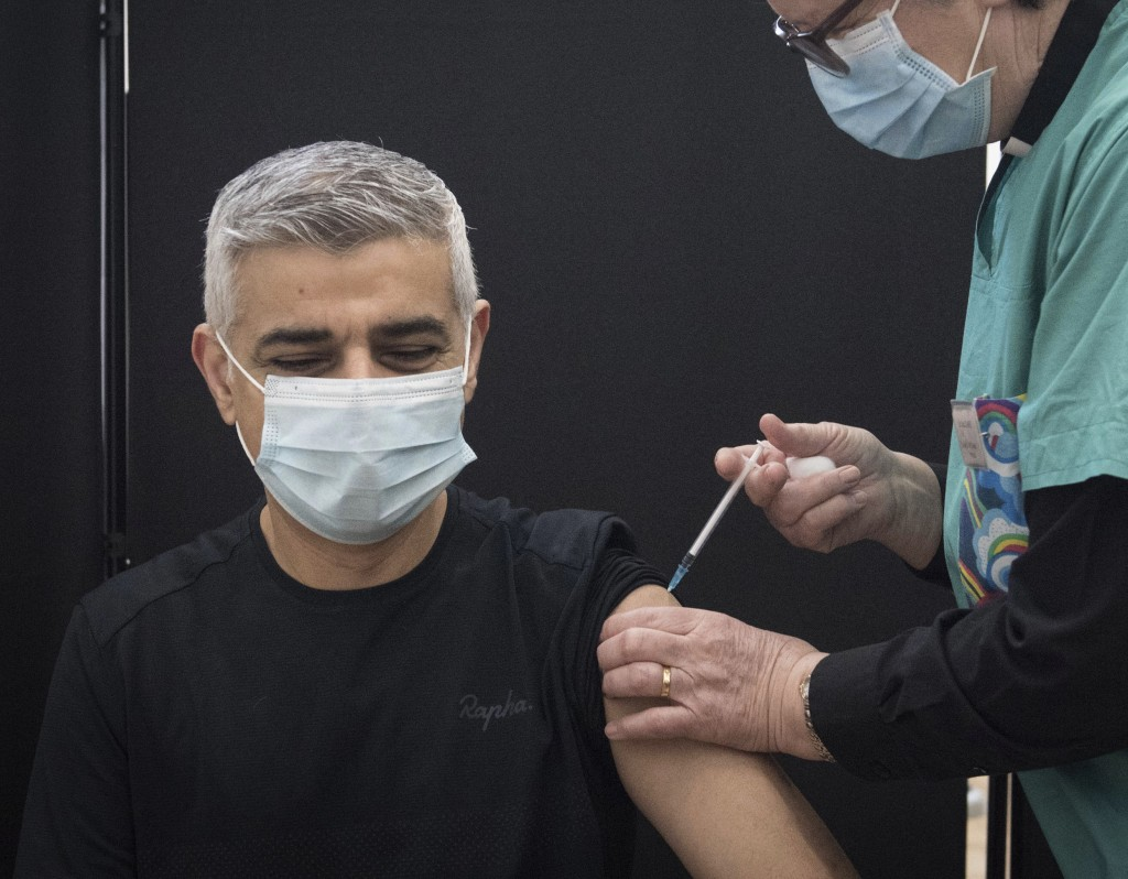 Mayor of London Sadiq Khan receives his first dose of the Pfizer coronavirus vaccine administered by Dr. Sue Clarke at a COVID-19 vaccination clinic a...