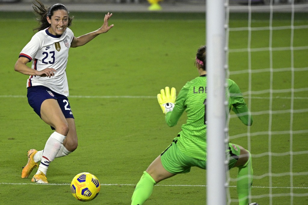 United States forward Christen Press (23) attempts a shot that is blocked by Canada goalkeeper Stephanie Labbe (1) during the second half of a SheBeli...