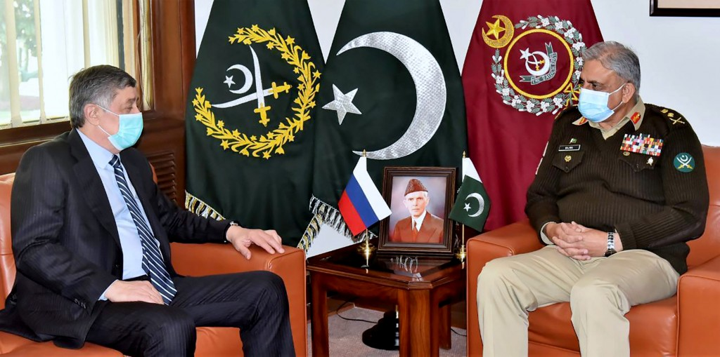 In this photo released by Inter Services Public Relations, Zamir Kabulov, left, Russia's President Vladimir Putin's special envoy on Afghanistan meets...