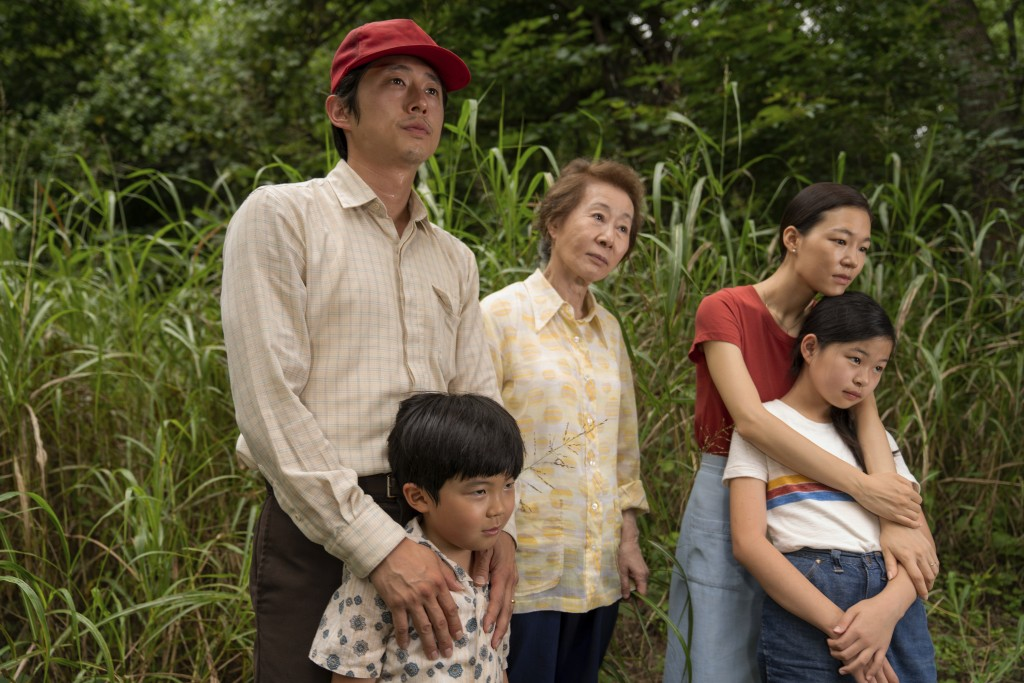 """This image released by A24 shows, from left, Steven Yeun, Alan S. Kim, Yuh-Jung Youn, Yeri Han, and Noel Cho in a scene from """"Minari.""""  (Josh Ethan Jo..."""