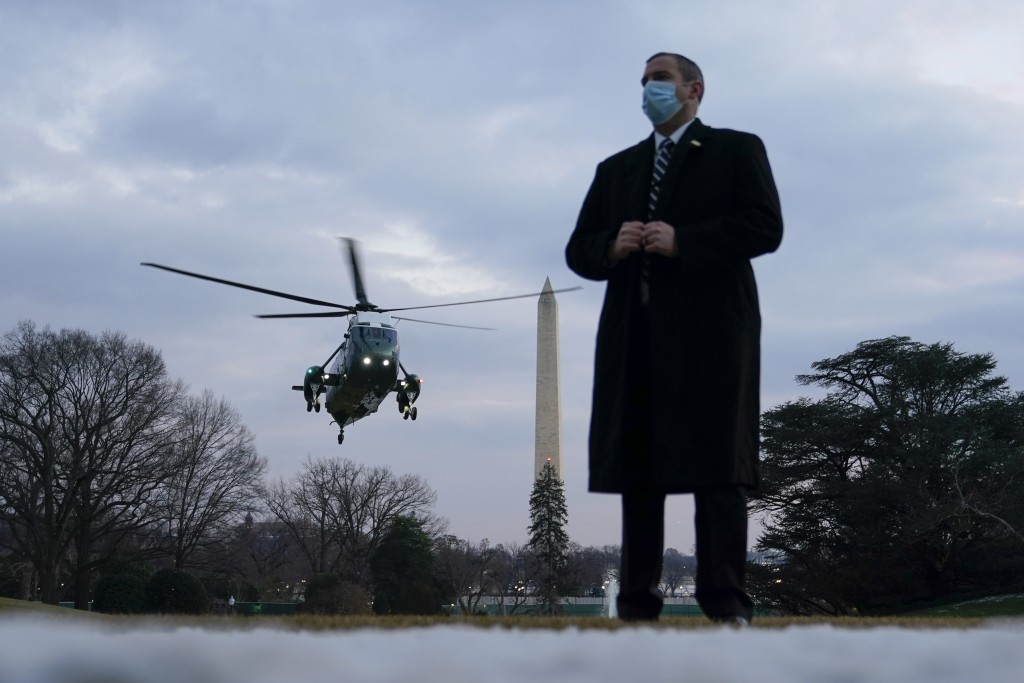 Marine One, with President Joe Biden aboard, approaches the South Lawn of the White House, Friday, Feb. 19, 2021, in Washington. Biden is returning to...