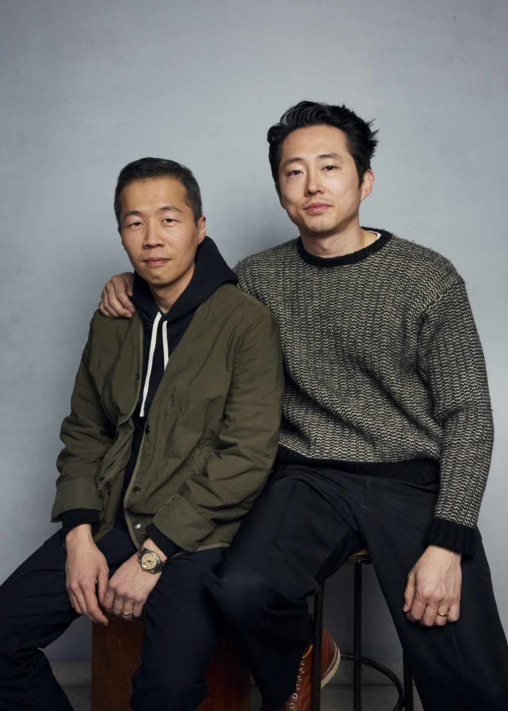 """FILE- Director Lee Isaac Chung, left, and Steven Yeun pose for a portrait to promote the film """"Minari"""" during the Sundance Film Festival in Park City,..."""
