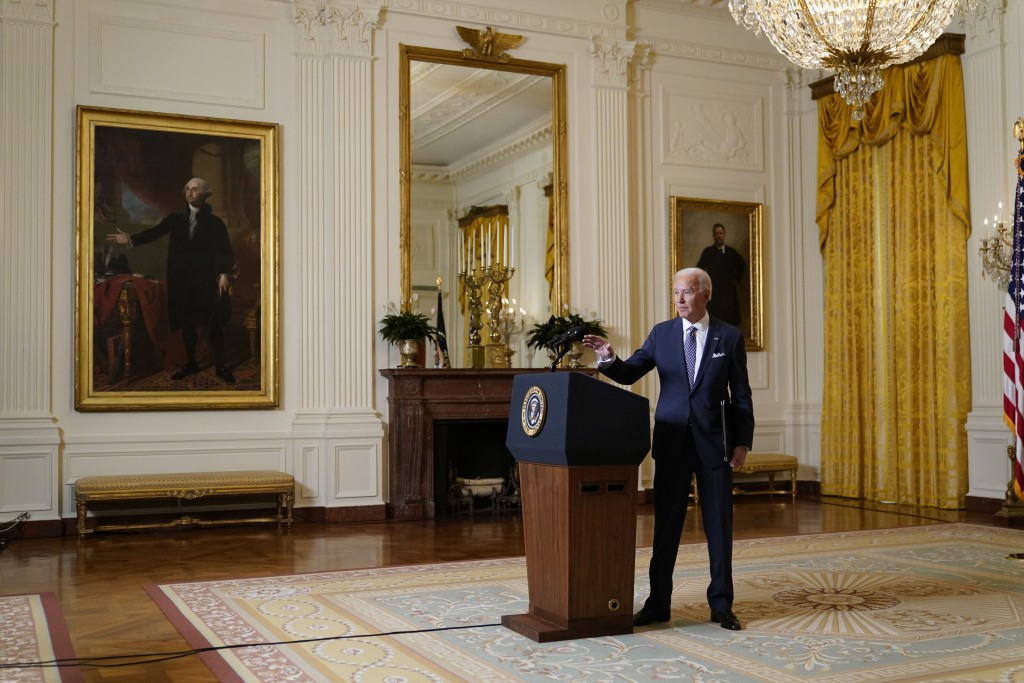 President Joe Biden leaves after a virtual event with the Munich Security Conference in the East Room of the White House, Friday, Feb. 19, 2021, in Wa...