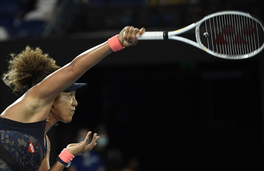 Japan's Naomi Osaka serves to United States' Jennifer Brady during the women's singles final at the Australian Open tennis championship in Melbourne, ...