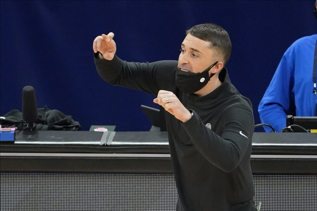 Minnesota Timberwolves coach Ryan Saunders gestures to players during the second half of the team's NBA basketball game against the Toronto Raptors, F...