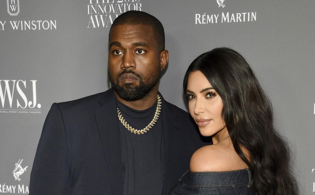 FILE - Kanye West, left, and Kim Kardashian attend the WSJ. Magazine Innovator Awards on Nov. 6, 2019, in New York. Kim Kardashian West filed for divo...