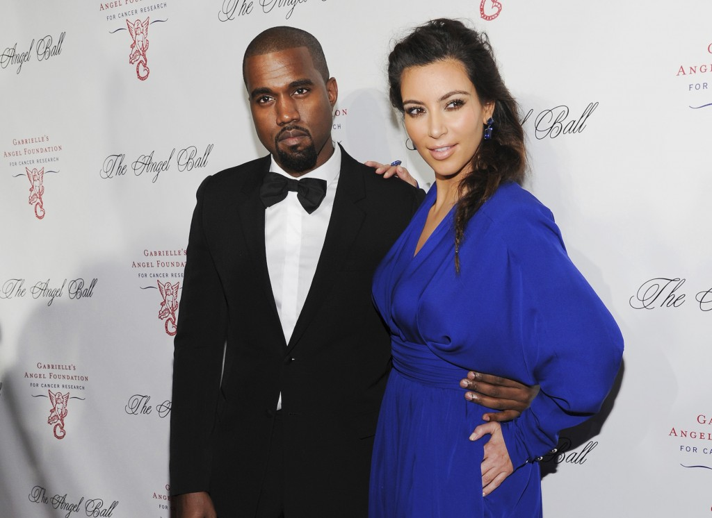 FILE - Kanye West, left, and Kim Kardashian attend Gabrielle's Angel Foundation Angel Ball cancer research benefit on Oct. 22, 2012, in New York. Kim ...